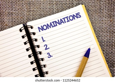 Word writing text Nominations. Business concept for Suggestions of someone or something for a job position or prize Ball point pen work spring diary chronicle daily routine jute background.