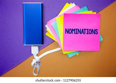 Word writing text Nominations. Business concept for Suggestions of someone or something for a job position or prize Multiple colour sticky remember cards data cable learn send message.