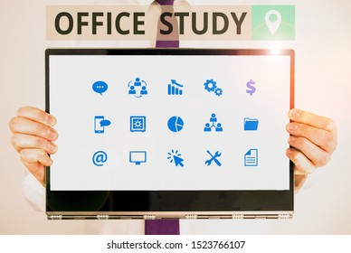Word writing text Office Study. Business concept for any location or venue where a demonstrating s is work is performed Male human holding thick textured cardboard of business promotion concept.