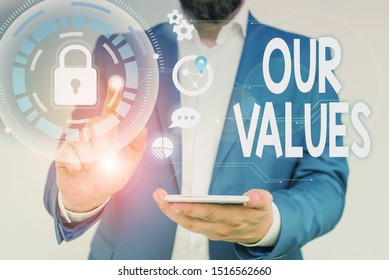 Word writing text Our Values. Business concept for list of morals companies or individuals commit to do them Male human wear formal work suit presenting presentation using smart device.