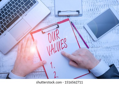 Word writing text Our Values. Business concept for list of morals companies or individuals commit to do them.