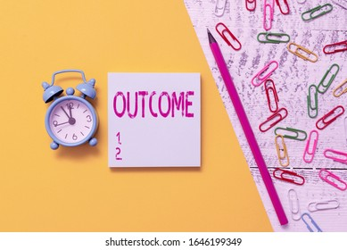 Word writing text Outcome. Business concept for the final result of something or how the way things end up Notepad marker pen colored paper sheet clips alarm clock wooden background.