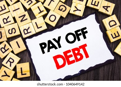 Word, writing, text  Pay Off Debt. Business concept for Reminder To Paying Owed Financial Credit Loan Bills written Skicky Note Paper the wood background.