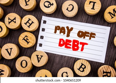 Word, writing, text  Pay Off Debt. Conceptual photo Reminder To Paying Owed Financial Credit Loan Bills written on tear paper on wooden background with letters.