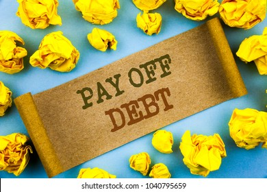 Word, writing, text  Pay Off Debt. Business concept for Reminder To Paying Owed Financial Credit Loan Bills written tear paper with folded paper the background.