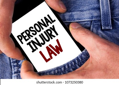 Word writing text Personal Injury Law. Business concept for guarantee your rights in case of hazards or risks written on Mobile phone holding by man on the Jeans background.