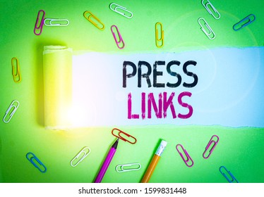 Word writing text Press Links. Business concept for intended to analysisipulate a site s is ranking in Google search Stationary and torn cardboard placed above a plain pastel table backdrop.