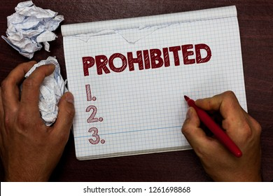 Word writing text Prohibited. Business concept for Something that has been forbidden banned restricted rejected Man holding marker notebook page crumpled papers several tries mistakes.