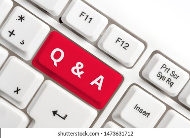 Word writing text Q And A. Business concept for defined as questions being asked and answers White pc keyboard with empty note paper above white background key copy space.