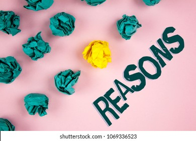 Word writing text Reasons. Business concept for Causes Explanations Justifications for an action or event Motivation written on plain Pink background Crumpled Paper Balls next to it.
