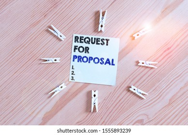 Word writing text Request For Proposal. Business concept for document contains bidding process by agency or company Colored clothespin papers empty reminder wooden floor background office.