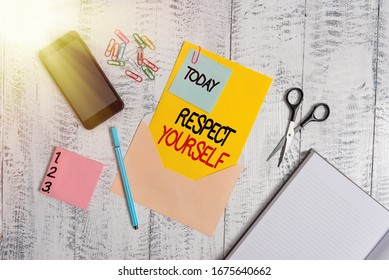 Word writing text Respect Yourself. Business concept for believing that you good and worthy being treated well Envelope sheet smartphone notes pen notepad clips scissors wooden back.