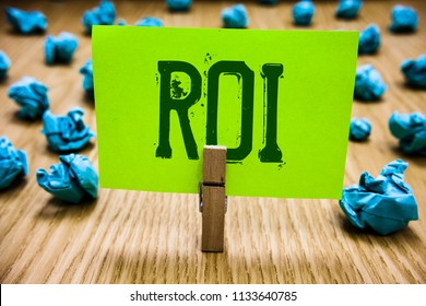 Word writing text Roi. Business concept for Return on investment performance measure gains business growth Paper cyan object thoughts crumpled papers ideas mistakes several tries.
