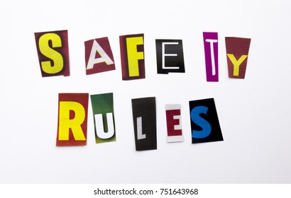 A word writing text showing concept of Safety Rules made of different magazine newspaper letter for Business case on the white background with space