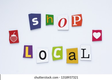 A word writing text showing shop local from cut letters on white background. Shopping concept. Rubric shop local. Text space.