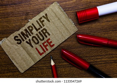Word writing text Simplify Your Life. Business concept for Manage your day work Take the easy way Organize Pen pencil cap board marker pointer text cardboard notice script idea.
