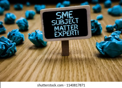 Word writing text Sme Subject Matter Expert. Business concept for Authority in a particular area or topic Domain Paperclip hold black paperboard with text blue paper lobs on wooden floor.