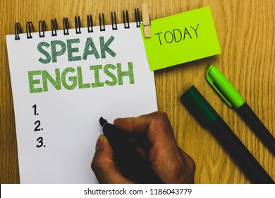 Word writing text Speak English. Business concept for Study another Foreign Language Online Verbal Courses Man holding marker notebook clothespin reminder wooden table cup coffee.