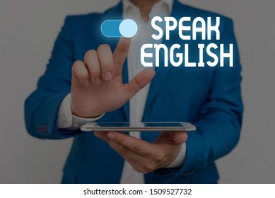 Word writing text Speak English. Business concept for Study another Foreign Language Online Verbal Courses Male human wear formal work suit presenting presentation using smart device.