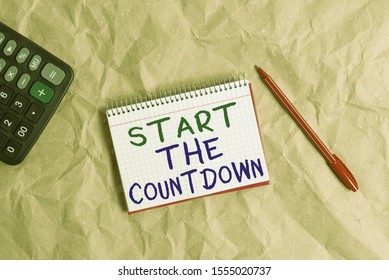 Word writing text Start The Countdown. Business concept for Sequence of Backward Counting to Set the Timer Papercraft craft paper desk square spiral notebook office study supplies.