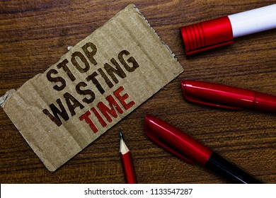 Word writing text Stop Wasting Time. Business concept for Organizing Management Schedule lets do it Start Now Pen pencil cap board marker pointer text cardboard notice script idea.