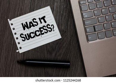 Word writing text Was It Success Question. Business concept for Happy feeling after achieving success in life Laptop nice computer notebook netbook pen small pitch paper pen wood.