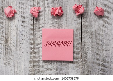 Word writing text Summary. Business concept for brief statement or account of main points of something subject Thick set of plain note paper with scraps on the wooden textured table.