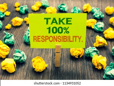 Word writing text Take 100 Responsibility.. Business concept for be responsible for list of things objects to do Clothespin holding yellow note paper crumpled papers several tries mistakes.