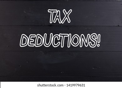 Word writing text Tax Deductions. Business concept for reduction income that is able to be taxed of expenses Wooden texture old vintage background horizontal boards holes. Old vintage.