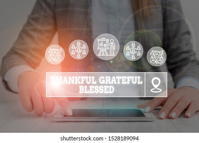 Word writing text Thankful Grateful Blessed. Business concept for Appreciation gratitude good mood attitude Woman wear formal work suit presenting presentation using smart device.