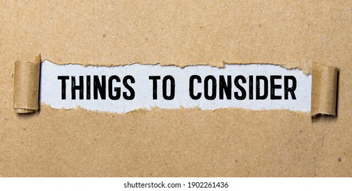 Word writing text Things To Consider. Business concept for think about something carefully in order to make decision Cardboard which is torn in the middle placed above a wooden classic table.