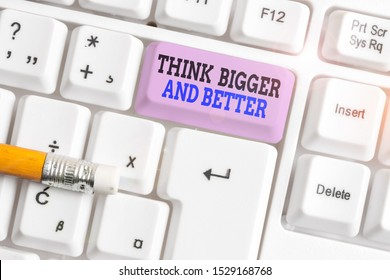 Word writing text Think Bigger And Better. Business concept for no Limits be Open minded Positivity Big Picture White pc keyboard with empty note paper above white background key copy space.