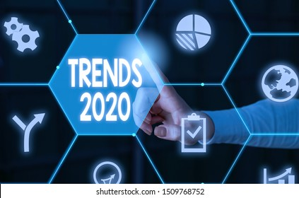 Word writing text Trends 2020. Business concept for Upcoming year prevailing tendency Widely Discussed Online Male human wear formal work suit presenting presentation using smart device.