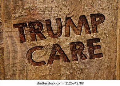 Word writing text Trump Care. Business concept for refers to replacement for Affordable Care Act in united states Message banner wood information board post plywood natural brown art.