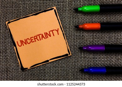 Word writing text Uncertainty. Business concept for Unpredictability of certain situations events behavior Marker pens art board small pitch paper lovely love ideas mat black shadow.