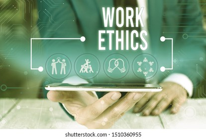 Word writing text Work Ethics. Business concept for A set of values centered on the importance of doing work Male human wear formal work suit presenting presentation using smart device.