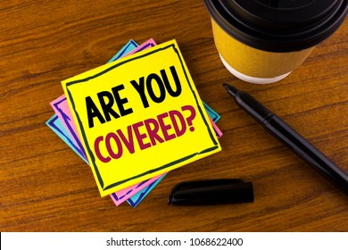 Word writing text Are You Covered Question. Business concept for Health insurance coverage disaster recovery written Sticky Note Paper wooden background Marker Cup next to it.