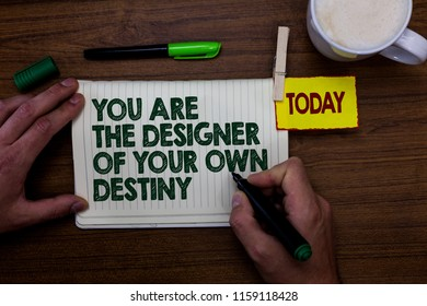 Word writing text You Are The Designer Of Your Own Destiny. Business concept for Embrace life Make changes Man holding marker notebook clothespin reminder wooden table cup coffee.