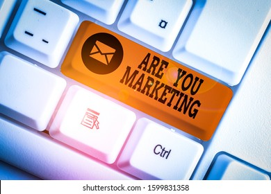 Word writing text Are You Marketing. Business concept for Actions to promote brand product Sales in market White pc keyboard with empty note paper above white background key copy space.