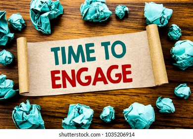 Word, writing Time To Engage. Business concept for Engagement Involvement Written on sticky note paper, wooden background folded yellow paper meaning thinking