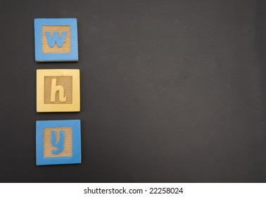Word written on childs chalkboard with colorful blocks