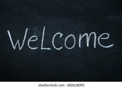 Word written in white chalk on blackboard