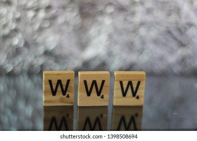 Word WWW meaning World Wide Web written on Scrabble letters. Editorial image, studio shot, macro photography.