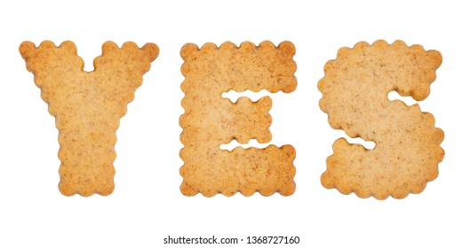 Word YES made of sweet cookie alphabet letters isolated on white background. Diet concept. Gluten-free concept