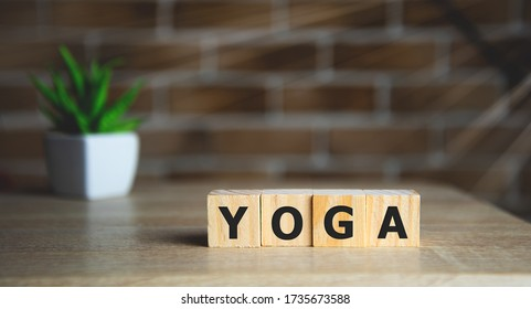 the word of YOGA on wooden cubes, meditation concept.