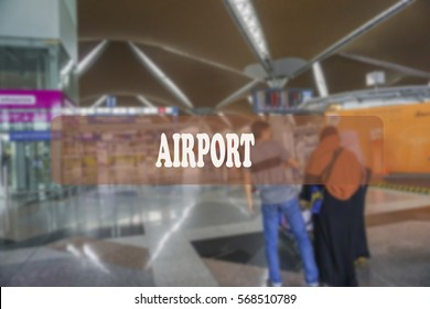 Wording airport with blurred airport background.