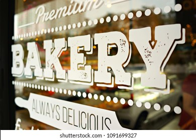 """Wording """"bakery"""" sticker put on clear glasses door or window of a cafe"""