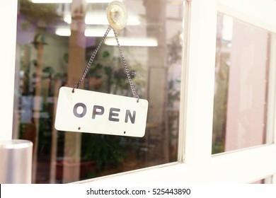 "Wording ""open"" label put on clear glasses door or window.Open daily letter wording sign sticker is symbol use for tell customer mostly put on front door of shop store and office.image use flare filter"