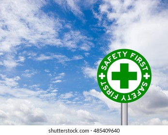 "wording ""Safety first"" in green traffic sign on blue sky background"