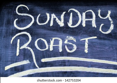 The wording text of Sunday Roast on a chalkboard. Concept photo of food and drinks.